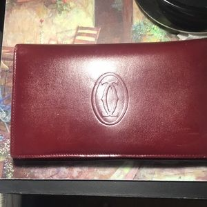 AUTHENTIC CARTIER WALLET WITH COINS.